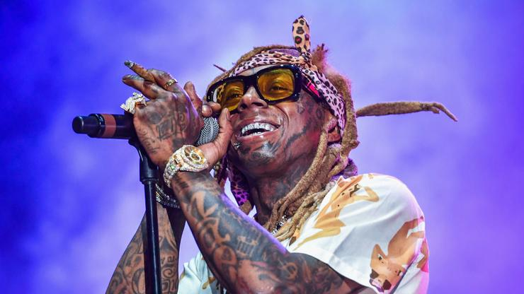 Lil Wayne Reps His Label With Blinding Young Money Chain