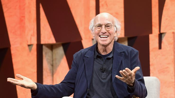 Larry David Caught Plugging Ears In Viral Clip From New York Fashion Week